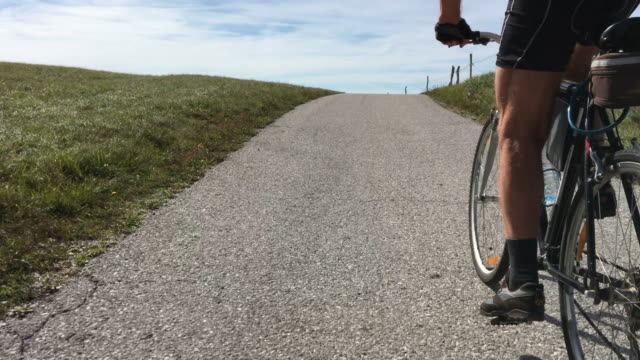senior man cycling uphill - uphill stock videos & royalty-free footage