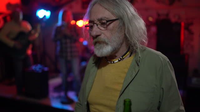 senior man dancing alone in nightclub - senior men stock videos & royalty-free footage