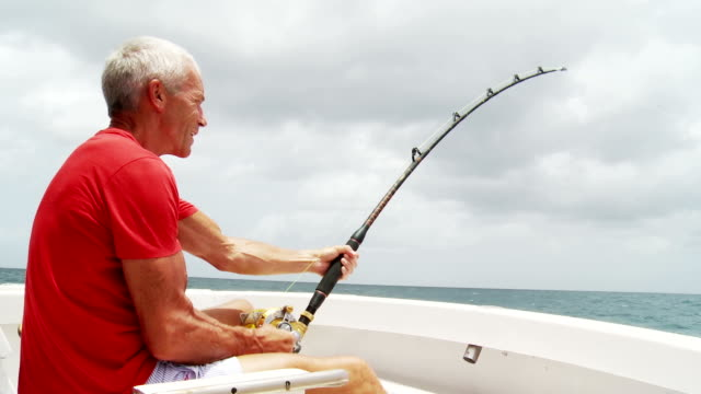 senior man deep sea fishing - fishing stock videos & royalty-free footage