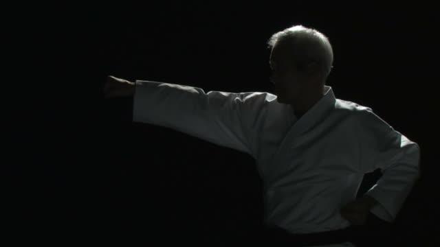 Senior man demonstrating karate