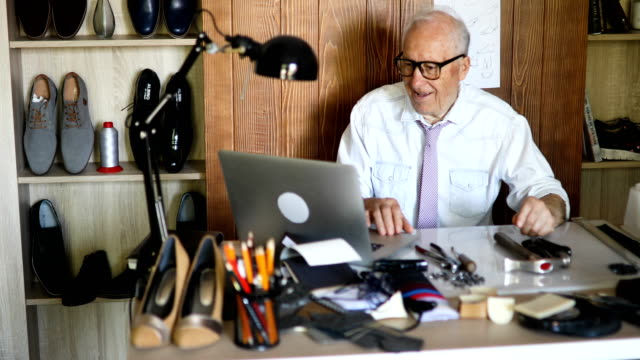 senior man designing shoes in a small office - retail occupation stock videos & royalty-free footage