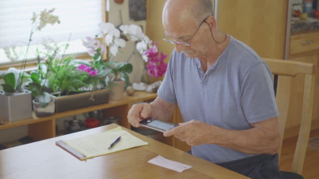 senior man does online banking - online banking video stock e b–roll
