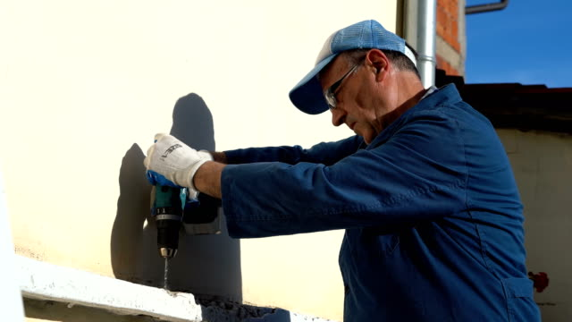 senior man doing house repairs - diy stock videos & royalty-free footage