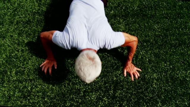 Senior man doing press ups