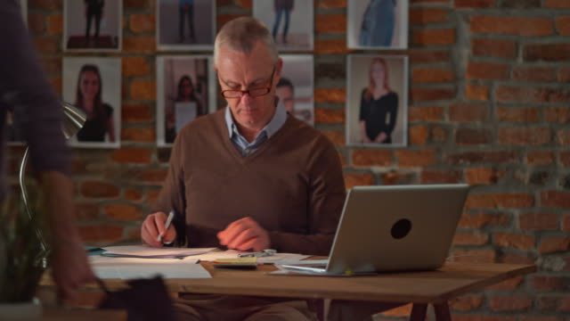 ds senior man drawing in a startup office at night - pair of compasses stock videos & royalty-free footage