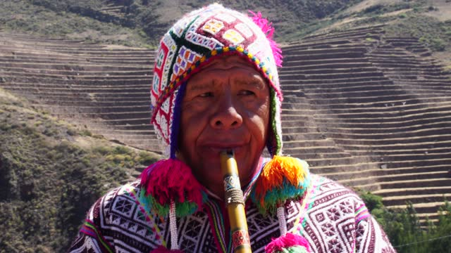 senior man dressing traditional peruvian clothing and playing flute - peruvian ethnicity stock videos & royalty-free footage