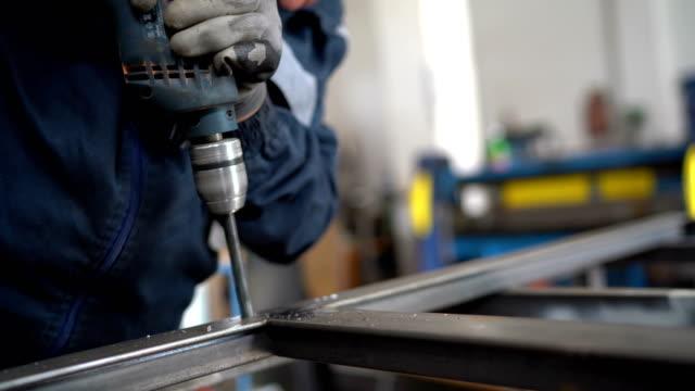 senior man drilling metal - iron metal stock videos & royalty-free footage