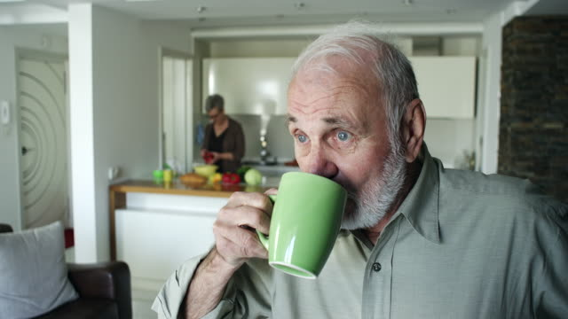 Senior man drinking coffee at home