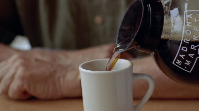cu, tu, senior man drinking coffee in diner  - kaffee getränk stock-videos und b-roll-filmmaterial