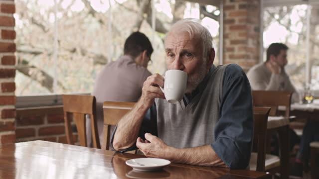 senior man drinking tea - cosy stock videos & royalty-free footage