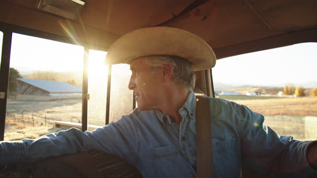 cu senior man driving an old truck on a farm - ranch stock videos & royalty-free footage