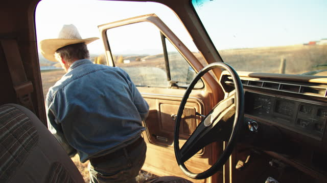 cu senior man driving an old truck on a farm - grey hair stock videos & royalty-free footage
