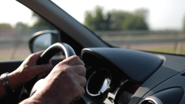 senior man driving car on the highway - steering wheel stock videos & royalty-free footage