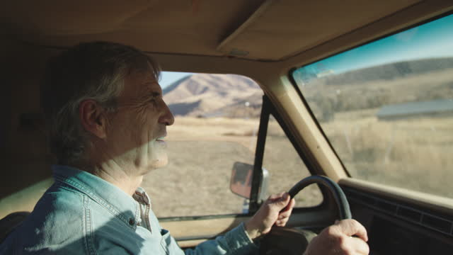 cu senior man driving his old truck on his farm - cowboy hat stock videos & royalty-free footage