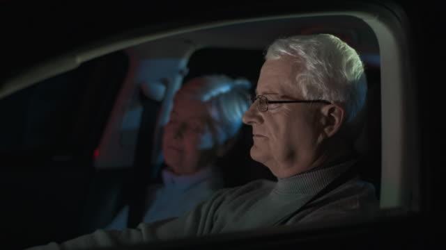 HD DOLLY: Senior Man Driving Late At Night