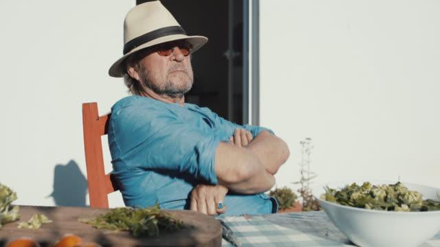 senior man enjoying sunshine on patio - real life stock videos & royalty-free footage
