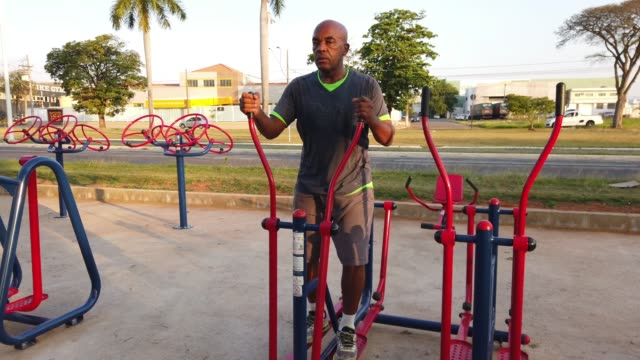 Senior man exercising at a public park.