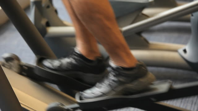 cu tu senior man exercising on elliptical machine in gym / richmond, virginia, usa - cross trainer stock videos and b-roll footage