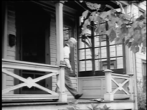 B/W 1943/44 senior man exits house, picks up newspaper from porch + enters house / Springfield, NJ