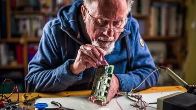 senior man fixing  electronic components - bricolage video stock e b–roll
