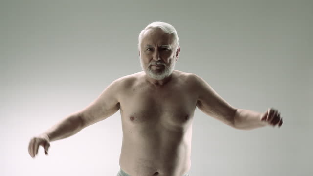 senior man flexing muscles - grey hair stock videos & royalty-free footage