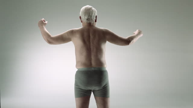 senior man flexing muscles - flexing muscles stock videos and b-roll footage
