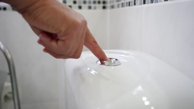 senior man flushing the toilet - domestic bathroom stock videos & royalty-free footage