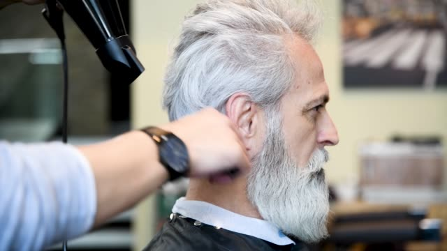 senior man getting hairstyle in hair salon - beard stock videos & royalty-free footage