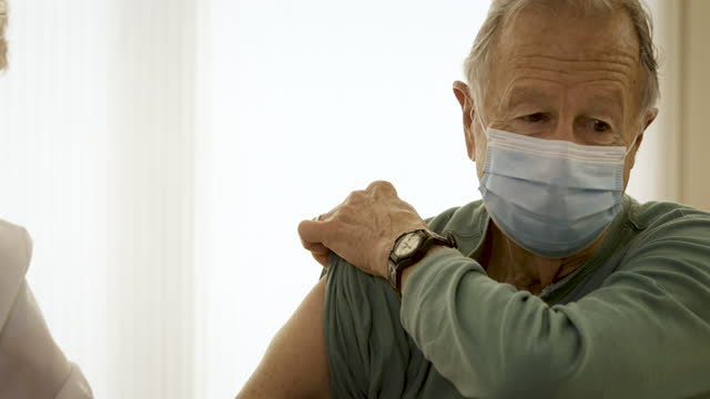 senior man getting vaccinated - protection stock videos & royalty-free footage