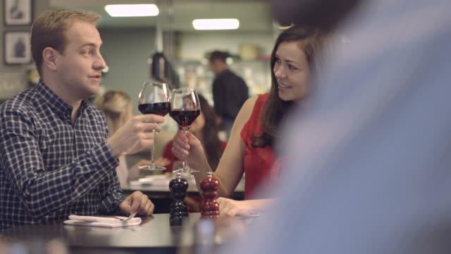 stockvideo's en b-roll-footage met ms pan senior man giving gift to woman in restaurant - overhemd en stropdas