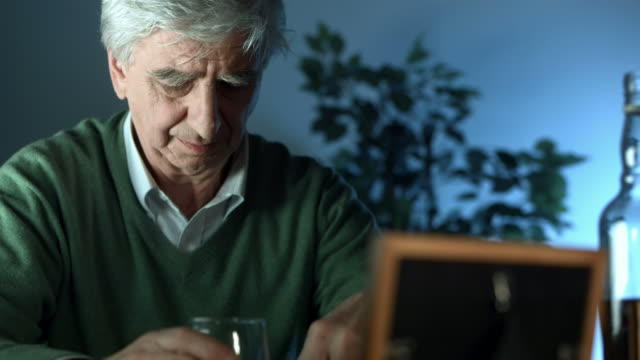 hd: senior man grieving for his lost - alcohol abuse stock videos and b-roll footage