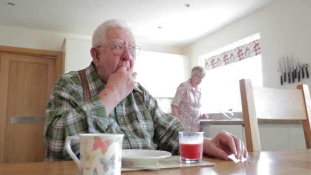 senior man having breakfast - healthcare worker stock videos & royalty-free footage