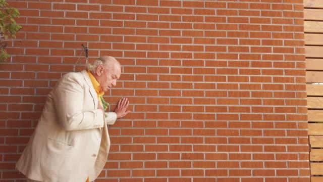 senior man having heart attack - heart attack stock videos & royalty-free footage