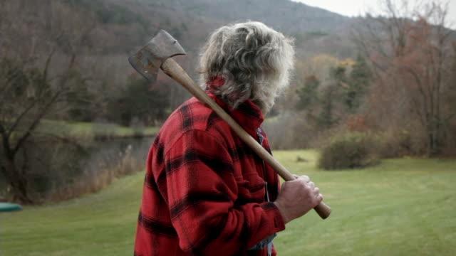 MS Senior man holding axe / Kingston, New York, USA