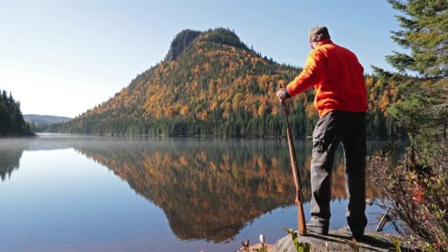 Senior Man Hunter Relaxing in Nature