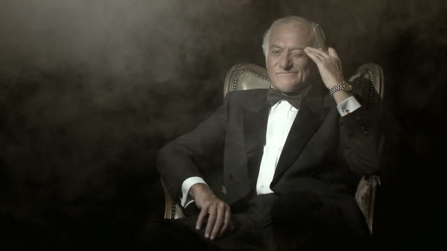 senior man in a dinner jacket, smoking a cigar - cigar stock videos & royalty-free footage