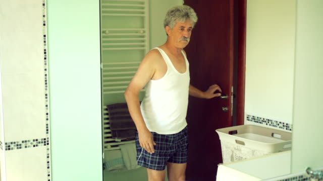 Senior man in bathroom