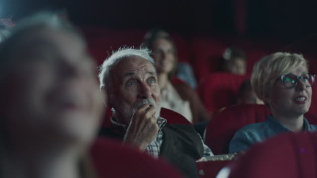 senior man in cinema - projection screen stock videos & royalty-free footage