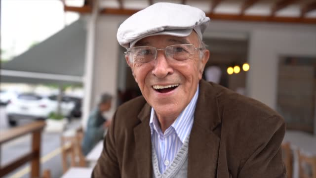 senior man in front of restaurant - one senior man only stock videos & royalty-free footage