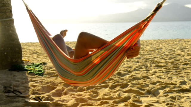 senior man in hammock on the beach - sunbathing stock videos & royalty-free footage