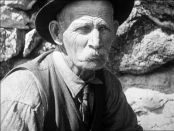 b/w 1927 portrait senior man in hat + mustache (dick raycroft) looking at camera + talking / news - moustache stock videos & royalty-free footage