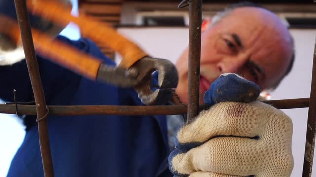 senior man in manual construction work - construction worker stock videos & royalty-free footage