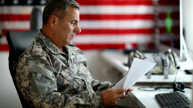 senior man in military uniform doing paper work - marines military stock videos & royalty-free footage