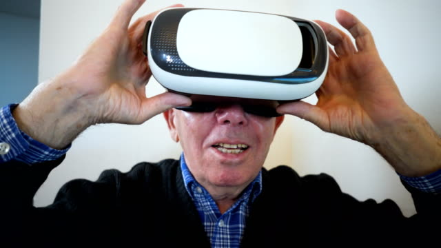 senior man in virtual reality experience - senior men stock videos & royalty-free footage