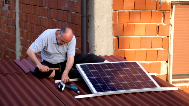 senior man installing solar panel - control panel stock videos & royalty-free footage