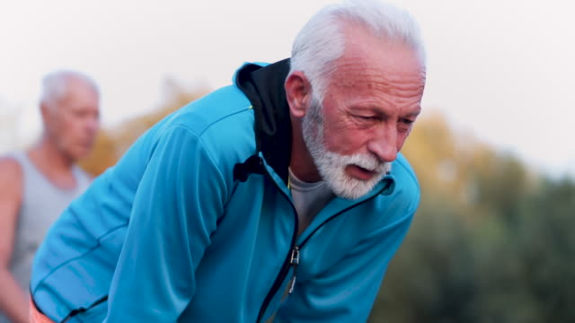 senior man is tired of running - exhaustion stock videos & royalty-free footage