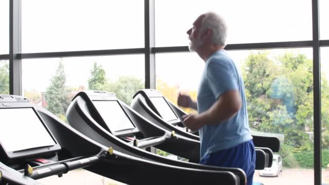 Senior man jogging on treadmill