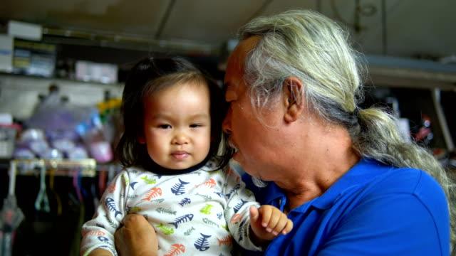 senior man kissing baby girl. - genderblend stock videos & royalty-free footage