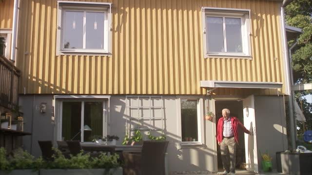 Senior man leaving his house, Sweden.