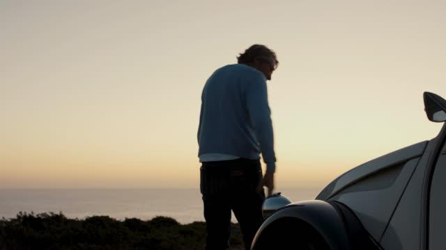 senior man looking at ocean at dusk - portugal stock videos & royalty-free footage